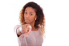 unhappy-young-african-american-pointing-finger-isolated-white-background-51005807