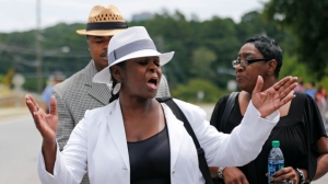 Leolah Brown talks with media members outside the church hosting a funeral service for her brother Bobby Brown's daughter, Bobbi Kristina Brown, Saturday, Aug. 1, 2015, in Alpharetta, Ga. She said she was angry because Pat Houston was speaking at the funeral. Pat Houston is the sister-in-law and former manager for the late Whitney Houston. Bobbi Kristina, the only child of Whitney Houston and R&B singer Bobby Brown, died in hospice care July 26, about six months after she was found face-down and unresponsive in a bathtub in her suburban Atlanta townhome. (AP Photo/John Bazemore)